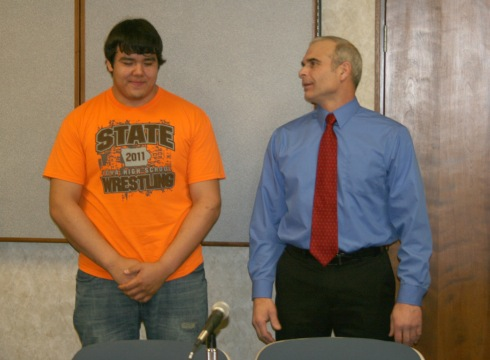 Pedro Gomez, who won the Class 3A 285-pound state wrestling title, was recognized in front of the School Board Monday night, along with his coach, Mike Mann. Gomez plans to attend Ellsworth Community College after graduating from Marshalltown High School, where he will play football and wrestle. Gomez is the first Bobcat to claim a state wrestling title since 2003.