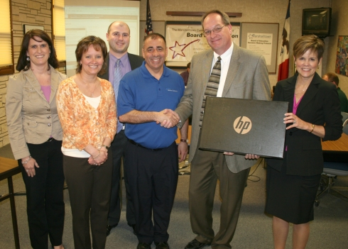 Five new HP laptops are heading to the Miller Middle School language arts department thanks to a grant from the EMC Insurance Foundation. Representatives from EMC were on hand Monday night to present the laptops to the district and be recognized for their contribution.